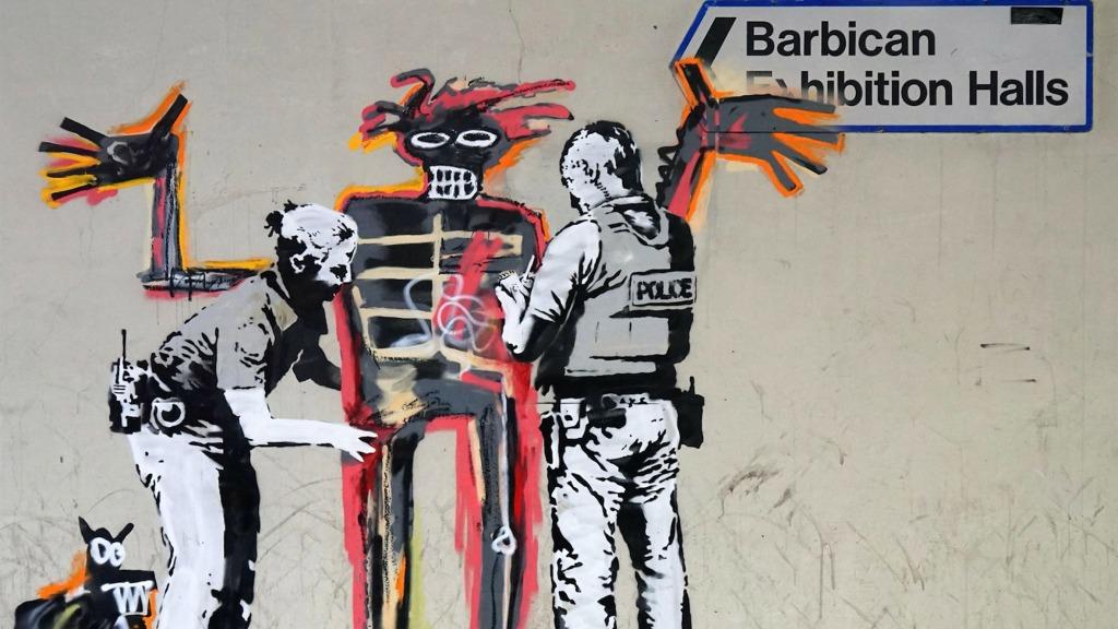 Banksy Jean MIchel Basquiat controle au facies